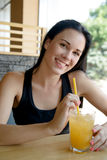Young European  woman drinking lemonade  in an cafe Royalty Free Stock Images