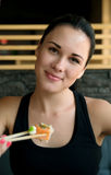 Young European  woman eating sushi in an Asian restaurant Stock Image