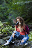 Young European woman hiker by the river Royalty Free Stock Images