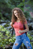 Young European woman hiker by the river Royalty Free Stock Image