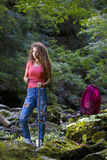 Young European woman hiker by the river Royalty Free Stock Photos