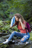 Young European woman hiker by the river Stock Photo