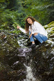 Young European woman hiker by the river Royalty Free Stock Photo