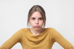 Free Young European Woman In Yellow Sweater Looking With Offended Look, Being Dissatisfied With Something Royalty Free Stock Photography - 119921117