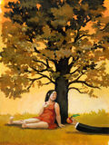 Young eva. Young woman sitting under a tree in a summer evening Royalty Free Stock Photo