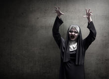 Young evil asian woman nun scare Stock Images