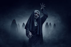 Young evil asian woman nun Stock Images