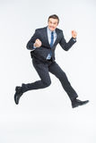 Young excited businessman. Jumping on white Royalty Free Stock Photos