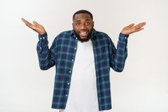 Young excited casual black man shocked on white background. Young excited casual black man shocked on white background royalty free stock photos