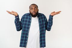 Young excited casual black man shocked on white background. Young excited casual black man shocked on white background stock photography