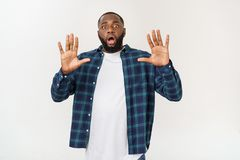 Young excited casual black man shocked on white background. Young excited casual black man shocked on white background stock images