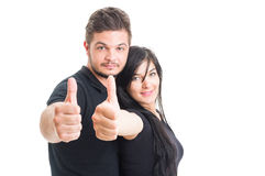 Young and excited couple showing like gesture Royalty Free Stock Photos