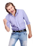 Young excited guy over white background Royalty Free Stock Photography