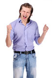 Young excited guy over white background Stock Photo