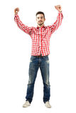 Young excited man with supportive encouraging raised hands. Full body length portrait isolated over white background Royalty Free Stock Image