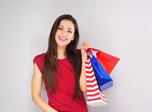Young excited toothy smiling woman with shopping bags. Happy New Year Holidays. Closeup portrait royalty free stock photography