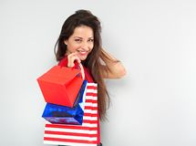 Young excited toothy smiling woman with shopping bags. Happy New Year Holidays. Closeup stock photos