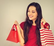 Young excited toothy smiling woman with shopping bags. Happy New Year Holidays stock photos