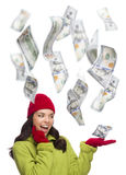 Young Excited Woman with $100 Bills Falling Around Her. Young Excited Warmly Dressed Woman with $100 Bills Falling Money Around Her on White Royalty Free Stock Photos
