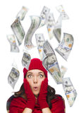 Young Excited Woman with $100 Bills Falling Around Her. Young Excited Warmly Dressed Woman with $100 Bills Falling Money Around Her on White Stock Photo