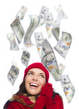 Young Excited Woman with $100 Bills Falling Around Her. Young Excited Warmly Dressed Woman with $100 Bills Falling Money Around Her on White Stock Photography