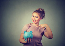 Young excited woman holding piggybank Stock Photo