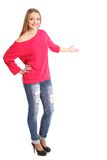 Young excited woman point finger showing something Stock Photography