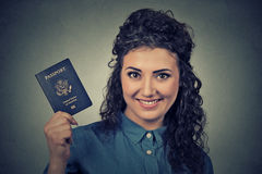 Young excited woman with USA passport Royalty Free Stock Image