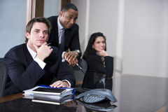 Young executive with colleagues Stock Images