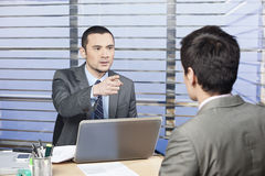 Young executive criticize the team member. Young executive in the office criticize the team member Royalty Free Stock Photography