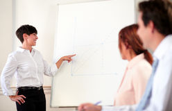 Young executive female giving a presentation Royalty Free Stock Images