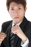 Young executive fighting Stock Images