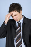 Young executive with headache Royalty Free Stock Photos