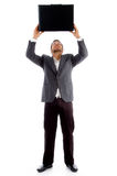 Young executive holding leather briefcase Royalty Free Stock Image