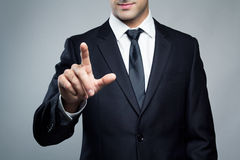Young executive man touching an imaginary screen Royalty Free Stock Photography