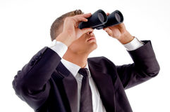 Young executive observing through binoculars Stock Photos