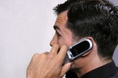Young executive on phone 2. Sales executive negotiates a big deal royalty free stock images