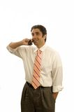 Young executive on phone. Young Iraninanexecutive on the phone isolated Stock Image