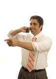 Young executive on phone. Young middle-eastern executive on the phone pointing Royalty Free Stock Image