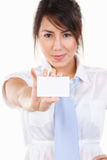 Young executive showing her name card. Young executive showing her blank name card, isolated on white. Main focus on the card Stock Image