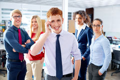 Young executive talking phone in multi ethnic team Stock Photos