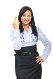 Young executive woman holding fingers crossed royalty free stock images