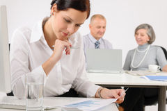 Young executive woman review charts Stock Images