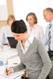 Young executive woman take notes during meeting Stock Photos