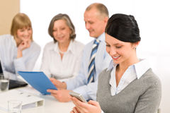 Young executive woman use phone during meeting Royalty Free Stock Images