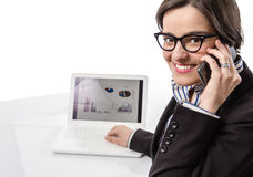 Young executive woman working on laptop computer a stock image