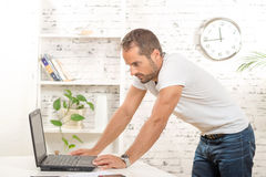 Young executive working with his computer Stock Photo