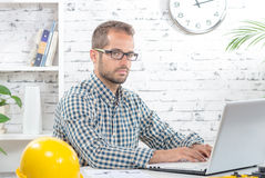 Young executive working with his computer Stock Photos