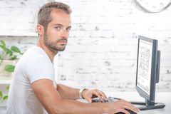 Young executive working with his computer Stock Image