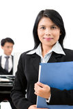 Young executives. A business woman standing in front of her colleague in the office stock photography